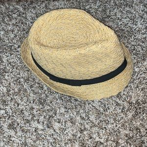 Woven hat with black ribbon